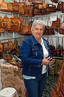 Cuba, Havana.  Woman Selling Leather Purses, Handicrafts Market.