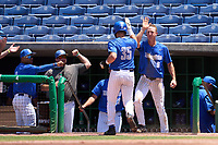 Memphis Tigers Hunter Goodman (35) high fives teammates, including Zach Wilson (6), after scoring a run during a game against the East Carolina Pirates on May 25, 2021 at BayCare Ballpark in Clearwater, Florida.  (Mike Janes/Four Seam Images)