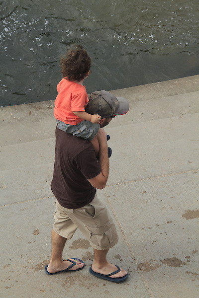 Father carries son on his shoulders in Boulder, Colorado. .  John offers private photo tours in Denver, Boulder and throughout Colorado. Year-round Colorado photo tours.