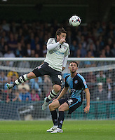 Ross McCormack of Fulham beats Danny Rowe of Wycombe Wanderers in the air during the Capital One Cup match between Wycombe Wanderers and Fulham at Adams Park, High Wycombe, England on 11 August 2015. Photo by Andy Rowland.