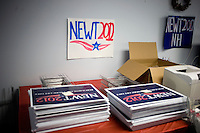 Campaign signs are stacked on a table at the Newt Gingrich New Hampshire campaign headquarters in Manchester, New Hampshire, on Jan. 7, 2012. Gingrich is seeking the 2012 Republican presidential nomination.