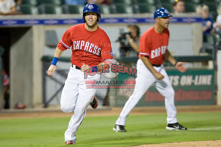 Round Rock Express first baseman Chad Tracy #28 rounds third base and heads home after being waved around by third base coach Spike Owen #11 during a game against the New Orleans Zephyrs at the Dell Diamond on July 20, 2011 in Round Rock, Texas.  New Orleans defeated Round Rock 14-11.  (Andrew Woolley/Four Seam Images)