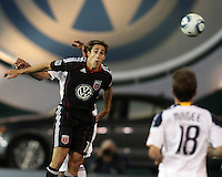 Josh Wolfe (16) of D.C. United heads towards Mike Magee (18) of the Los Angeles Galaxy during an MLS match at RFK Stadium, on April 9 2011, in Washington D.C.The game ended in a 1-1 tie.