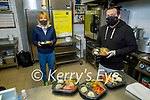 Paddy Kevane (President of Tralee St Vincent de Paul) and Les Galvin preparing the Meals on Wheels in Osnam House.