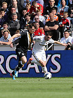 Pictured: Angel Rangel (R).<br /> Sunday 19 May 2013<br /> Re: Barclay's Premier League, Swansea City FC v Fulham at the Liberty Stadium, south Wales.