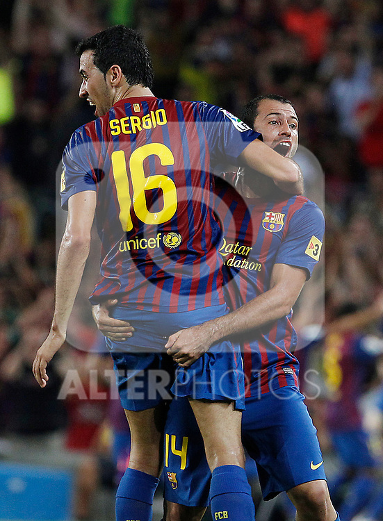 FC Barcelona's Sergio Busquets (l) and Javier Mascherano celebrates goal during Spanish Supercup 2nd match.August 17,2011. (ALTERPHOTOS/Acero)