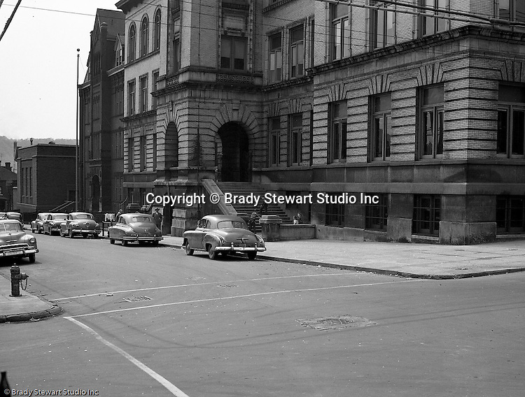 Pittsburgh PA:  Location photography of another Railway Express accident scene for attorney's Reed Smith, Shaw, and McClay.  View of the Conroy Junior High School (on the right) at the corner of  Page and Fulton streets on the North Side of Pittsburgh.