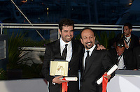 Shahab Hosseini (L) poses with the award for Best Actor for the movie 'The Salesman' and director Asghar Farhadi poses with his award for the Best Screenplay for the movie 'The Salesman (Forushande)' during the Palme D'Or Winner Photocall during the 69th annual Cannes Film Festival at the Palais des Festivals on May 22, 2016 in Cannes, France.