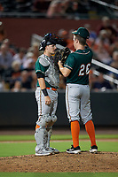 Greensboro Grasshoppers catcher Grant Koch (34) talks with pitcher Will Kobos (26) during a South Atlantic League game against the Delmarva Shorebirds on August 21, 2019 at Arthur W. Perdue Stadium in Salisbury, Maryland.  Delmarva defeated Greensboro 1-0.  (Mike Janes/Four Seam Images)