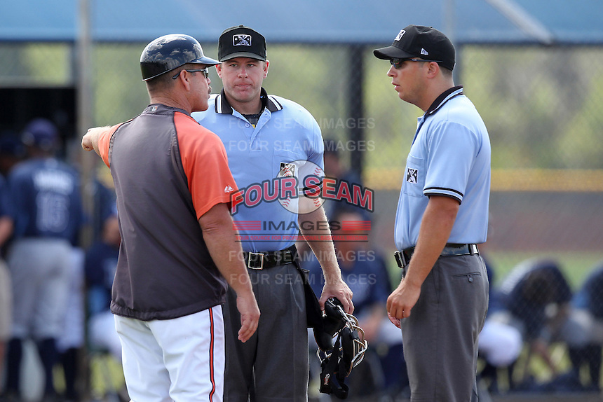 Baltimore Orioles manager Gary Allenson argues a call with umpires Sam Vogt and Brian Peterson (middle) during an extended spring training game against the Tampa Bay Rays at the Charlotte County Sports Park on April 28, 2012 in Port Charlotte, Florida.  (Mike Janes/Four Seam Images)