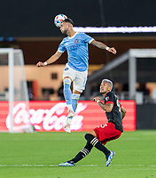 WASHINGTON, DC - APRIL 17: Valentin Castellanos #11 of New York City FC goes up for a header over Tony Alfaro #93 of D.C. United during a game between New York City FC and D.C. United at Audi Field on April 17, 2021 in Washington, DC.