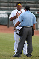 Phoenix Desert Dogs manager Todd Steverson #31 argues a call with home plate umpire Eric Loveless during an Arizona Fall League game against the Salt River Rafters at Phoenix Municipal Stadium on November 1, 2011 in Phoenix, Arizona.  Salt River defeated Phoenix 10-7.  (Mike Janes/Four Seam Images)