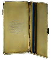 BNPS.co.uk (01202) 558833. <br /> Pic: Spink&Son/BNPS<br /> <br /> Pictured: Tubby's personalised cigarette case is part of the sale.<br /> <br /> The bravery medals of a larger-than-life hero Pathfinder pilot who clocked up a staggering 100 bombing raids have emerged for sale for £32,000.<br /> <br /> Wing Commander Sidney 'Tubby' Baker, who was known for his love of food, drink and cigarettes, repeatedly risked his life in attacks on heavily defended German and Italian targets.<br /> <br /> Upon returning to his airbase after completing his century, the No 635 Squadron commander was handed a well-earned pint of beer and 'grounded with immediate effect'.<br /> <br /> As was his custom, he downed the drink and puffed on a celebratory cigarette.