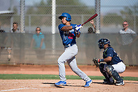 Los Angeles Dodgers infielder Marcus Chiu (22) follows through on his swing in front of catcher Caleb Marquez (35) during an Instructional League game against the Milwaukee Brewers at Maryvale Baseball Park on September 24, 2018 in Phoenix, Arizona. (Zachary Lucy/Four Seam Images)