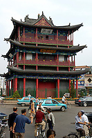 City traffic passes by in front of a pagoda in Datong, Shanxi, China.