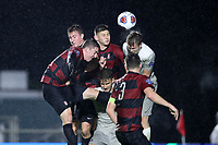 CARY, NC - DECEMBER 13: Gabe Segal #17, Ryan Ludwick #12, and Cam Cilley #16 of Stanford University challenge for a header with Will Sands #14 and JB Fischer #8 of Georgetown University during a game between Stanford and Georgetown at Sahlen's Stadium at WakeMed Soccer Park on December 13, 2019 in Cary, North Carolina.