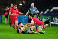 Luke Morgan of Ospreys is tackled by Sean Maitland of Saracens during the Heineken Champions Cup Round 5 match between the Ospreys and Saracens at the Liberty Stadium in Swansea, Wales, UK. Saturday January 11 2020.