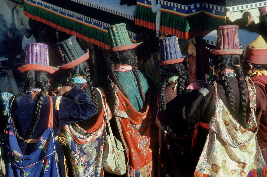Ladakhi women wearing traditional SILK EMBROIDERED TALL HATS, TIKSE Monastery Masked Dances - LADAKH, INDIA