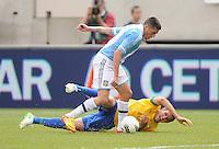 Argentina midfielder Jose Sosa (8) goes against Brazil defender Bruno Univi (13) The Argentina National Team defeated Brazil 4-3 at MetLife Stadium, Saturday July 9 , 2012.