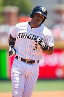 Micah Johnson (3) of the Charlotte Knights rounds the bases after hitting a home run against the Indianapolis Indians at BB&T BallPark on June 21, 2015 in Charlotte, North Carolina.  The Knights defeated the Indians 13-1.  (Brian Westerholt/Four Seam Images)