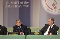 April 22,  2001, Quebec, Quebec, Canada<br /> <br /> Jean Chretien, Canada's Prime Minister (L)  listen while <br /> George W, Bush, United States of Americas President (R)<br />  speak at the closing press conference of the Summit of the Americas , April 22, 2001 in Quebec City, CANADA.