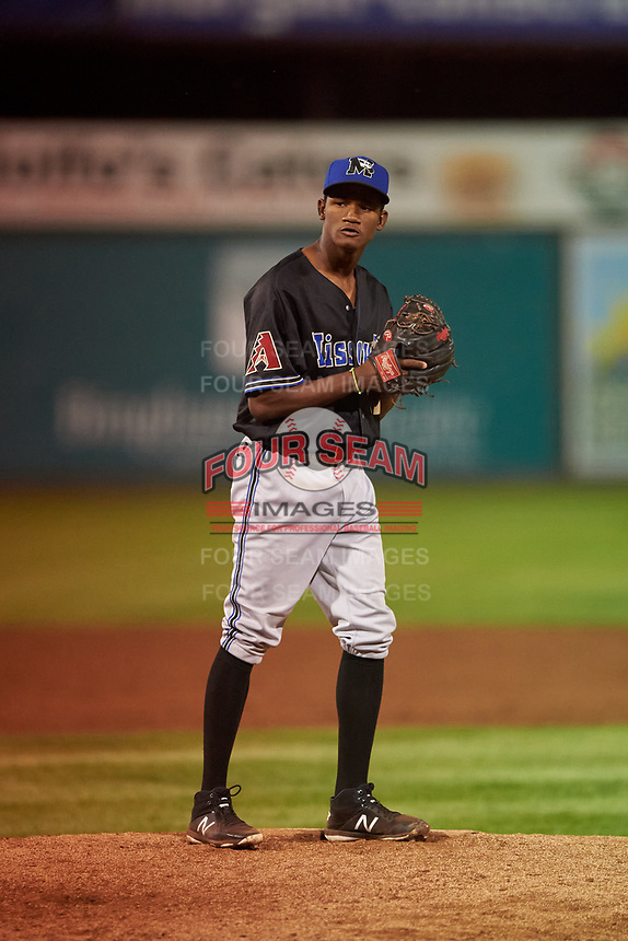 Missoula Osprey relief pitcher Oliver Rosario (17) prepares to deliver a pitch during a Pioneer League game against the Idaho Falls Chukars at Melaleuca Field on August 20, 2019 in Idaho Falls, Idaho. Idaho Falls defeated Missoula 6-3. (Zachary Lucy/Four Seam Images)