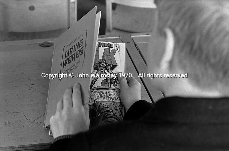 Boys hiding stuff from the teacher, Whitworth Comprehensive School, Whitworth, Lancashire.  1970.