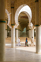 Senegal, Touba. Three Worshippers Leaving the Grand Mosque--two men and a woman.