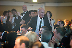 © Joel Goodman - 07973 332324 . 05/03/2015 .  Midland Hotel , Manchester , UK . Winner Ian Lewis of LHS walks to the stage to collect his award . Regulatory Team of the Year . The Manchester Legal Awards 2015 . Photo credit : Joel Goodman