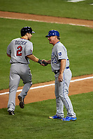Minnesota Twins Brian Dozier shakes hands with Kansas City Royals coach as he rounds the bases after hitting a home run during the MLB All-Star Game on July 14, 2015 at Great American Ball Park in Cincinnati, Ohio.  (Mike Janes/Four Seam Images)