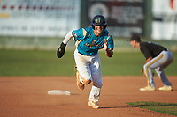 Anthony Hennings (3) (Elon) of the Mooresville Spinners hustles towards third base against the Concord A's at Moor Park on July 31, 2020 in Mooresville, NC. The Spinners defeated the Athletics 6-3 in a game called after 6 innings due to rain. (Brian Westerholt/Four Seam Images)