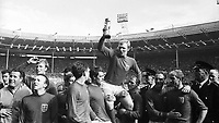30.07.1966. Wembley Stadium, London England. 1966 World Cup final England versus Germany (4-2) After Extra time.  England team captain Bobby Moore hold the cup aloft supported by Nobby Stiles, Jackie Charlton, Alan Ball, Geoff Hurst, Martin Peters, Bobby Charlton, George Cohen, Ray Wilson and Roger Hunt.
