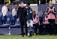 CARSON, CA - MARCH 07: Marc Dos Santos head coach of the Vancouver Whitecaps has a few words with Janio Bikel #19 during a game between Vancouver Whitecaps and Los Angeles Galaxy at Dignity Health Sports Park on March 07, 2020 in Carson, California.