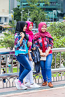 Young Malaysian Women Posing for a Photo, KLCC Park, Kuala Lumpur, Malaysia.