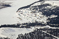 Aerial of the village of White Mountain with dog teams resting during Iditarod 2008