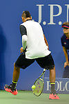 Despite a between the legs shot, Nick Kyrgios (AUS) loses the first set to Andy Murray (GBR) 7-5 at the US Open in Flushing, NY on September 1, 2015.