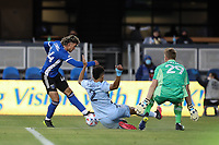 SAN JOSE, CA - MAY 22: Cade Cowell #44 of the San Jose Earthquakes is defended by Jaylin Lindsey #2 and Tim Melia #29 of Sporting Kansas City during a game between Sporting Kansas City and San Jose Earthquakes at PayPal Park on May 22, 2021 in San Jose, California.