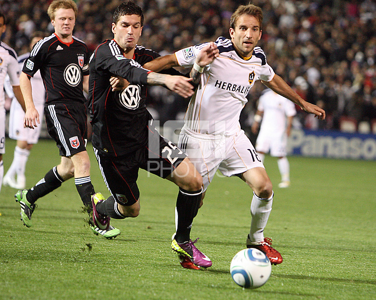 Santino Quaranta (25) of D.C. United challenges for the ball with Mike Magee (18) of the Los Angeles Galaxy during an MLS match at RFK Stadium, on April 9 2011, in Washington D.C.The game ended in a 1-1 tie.
