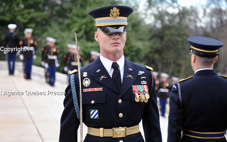 With full Ceremonial Honors presented, a member of the U.S. Army Honor Guard performs facing movements at the Tomb of the Unknowns prior to the arrival of The Right Honorable Justin Trudeau, Prime Minister of Canada. The Prime Minister was at Arlington National Cemetery to lay a wreath at the Tomb of the Unknowns in honor of the Prime Minister's official visit to the United States. (Department of Defense photo by Marvin Lynchard)