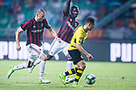 Borussia Dortmund Midfielder Emre Mor (R) fights for the ball with AC Milan Defender Gabriel Paletta (L) during the International Champions Cup 2017 match between AC Milan vs Borussia Dortmund at University Town Sports Centre Stadium on July 18, 2017 in Guangzhou, China. Photo by Marcio Rodrigo Machado / Power Sport Images