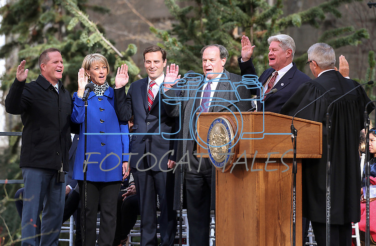 Nevada Constitution officers, from left, Lt. Gov. Mark Hutchison, Secretary of State Barbara Cegavske, Attorney General Adam Laxalt, Treasurer Dan Schwartz and Controller Ron Knecht take the oath of office from Supreme Court Chief Justice James Hardesty on the steps of the Capitol, in Carson City, Nev., on Monday, Jan. 5, 2015. (Las Vegas Review-Journal/Cathleen Allison)