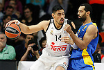 Real Madrid's Gustavo Ayon (l) and Maccabi Electra Tel Aviv's Brian Randle during Euroleague match.March 27,2015. (ALTERPHOTOS/Acero)