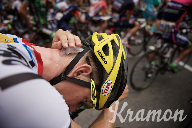 As it is yet another hot day in the Tour, Sep Vanmarcke (BEL/LottoNL-Jumbo) tries to keep cool by rubbing ice against his neck before the stage start<br /> <br /> stage 14: Rodez - Mende (178km)<br /> 2015 Tour de France