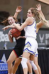 SIOUX FALLS, SD - MARCH 6: Tylee Irwin #21 of the South Dakota State Jackrabbits battles for a loose ball with Sarah Schmitt #1 of the Omaha Mavericks during the Summit League Basketball Tournament at the Sanford Pentagon in Sioux Falls, SD. (Photo by Richard Carlson/Inertia)