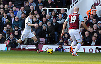 Pictured L-R: Ben Davies of Swansea against James Collins of West Ham. 01 February 2014<br /> Re: Barclay's Premier League, West Ham United v Swansea City FC at Boleyn Ground, London.
