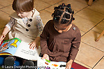 Education preschool 2-4 year olds two girls sitting side by side looking at picture books horizontal