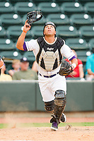 Winston-Salem Dash catcher Miguel Gonzalez #3 chases after a foul pop fly during the Carolina League game against the Myrtle Beach Pelicans at BB&T Ballpark on July 5, 2012 in Winston-Salem, North Carolina.  The Dash defeated the Pelicans 12-5.  (Brian Westerholt/Four Seam Images)