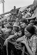 """28 Dec 1978, Manila, Luzon Island, Philippines --- Boat people stranded on the ship """"Tung-An"""", off the coast of Manila after an exodus from Vietnam. The 2700 Vietnamese refugees on board do not have the permission to disembark into the Philippines. Hungry, tired, and scared, living in unbearable conditions, the boat people must wait until a host country accepts them. --- Image by © JP Laffont"""