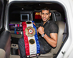 © Joel Goodman - 07973 332324 . 26/07/2011 . Manchester , UK . Boxer AMIR KHAN arrives back in NW England at Manchester Airport after defeating Zab Judah in the light-welterweight unification fight in Las Vegas . Photo credit : Joel Goodman