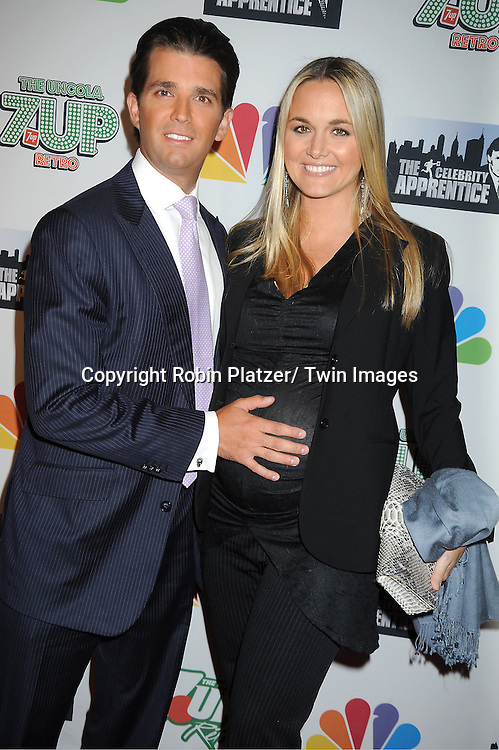 """Donald Tump, Jr and wife Vanessa posing for photographers at """"The Celebrity Apprentice"""".Season Four Finale Party on May 22, 2011 at The Trump Soho Hotel in New York City."""